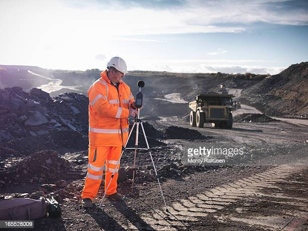 Ecologist monitoring sound in surface coal mine