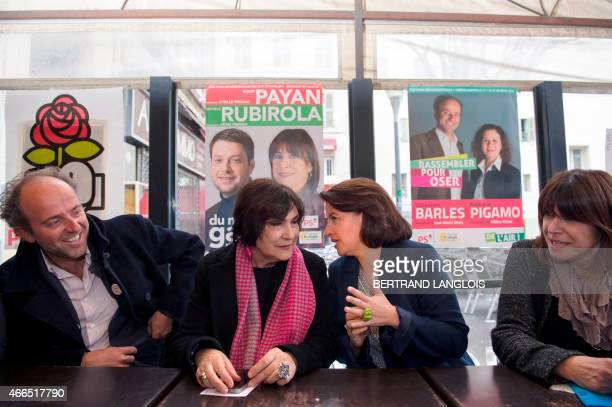 EELV ecologist party member of parliament and former minister Cecile Duflot speaks to French former Minister MarieArlette Carlotti during a meeting...