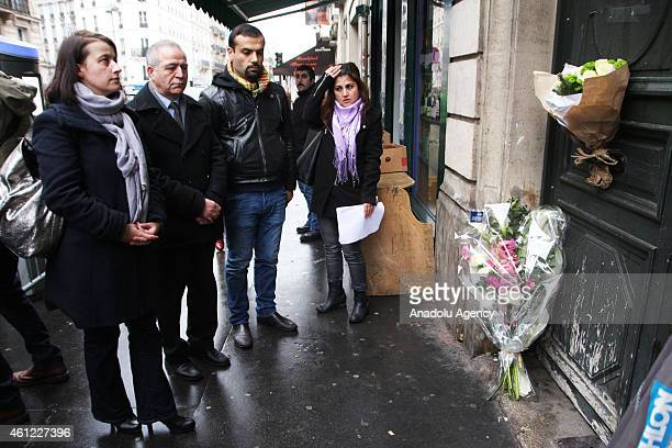 EELV ecologist party's member of Parliament and former minister Cecile Duflot arrives as flowers are left in front of the building where Sakine...