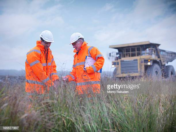 Ecologists at surface coal mine restoration collecting grass seeds