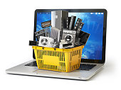 E-commerce online shopping or delivery concept. Home appliance in shopping cart on the laptop keyboard isolated on white. 3d illustration