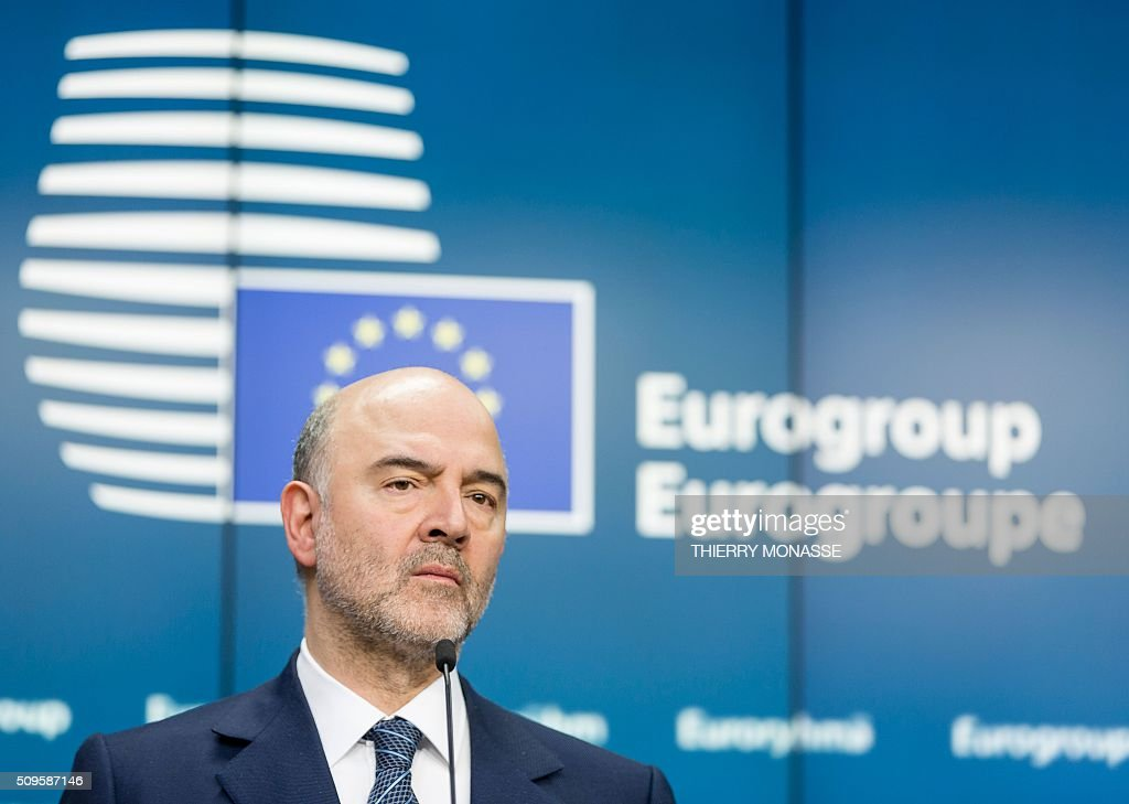 EU Economic and Financial Affairs, Taxation and Customs Commissioner Pierre Moscovici addresses a press conference following a meeting of Eurogroup ministers at the European Council headquarters in Brussels on February 11, 2016. / AFP / THIERRY MONASSE