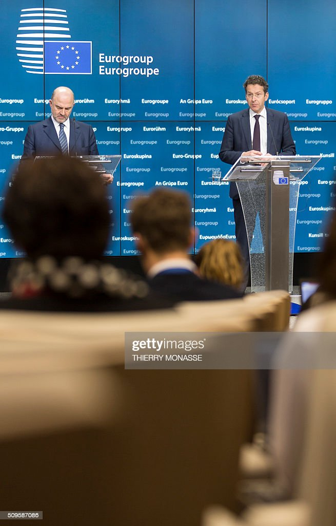 EU Economic and Financial Affairs, Taxation and Customs Commissioner Pierre Moscovici (L) and Eurogroup President and Dutch Finance Minister Jeroen Dijsselbloem address a press conference following a meeting of Eurogroup ministers at the European Council headquarters in Brussels on February 11, 2016. / AFP / THIERRY MONASSE