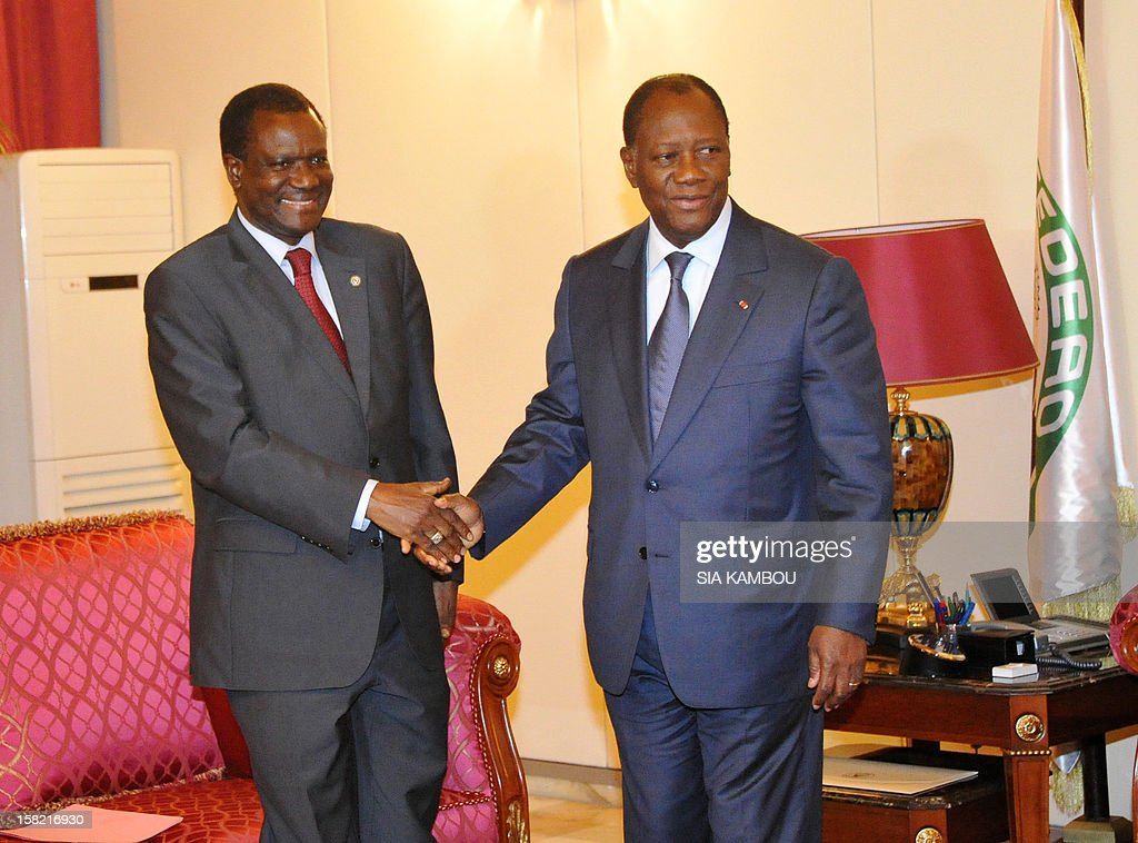Economic Community of West African States (ECOWAS) president of the regional bloc's executive commission, Kadre Desire Ouedraogo and Economic Community of West African States (ECOWAS) president and Ivory Coast President Alassane Ouattara (R), pose during a press conference in Abidjan on December 11, 2012. West African nations today condemned the role of Mali's ex-military junta in forcing prime minister Cheick Modibo Diarra to resign, calling for an inclusive government to be established in the crisis-torn country. AFP PHOTO / SIA KAMBOU