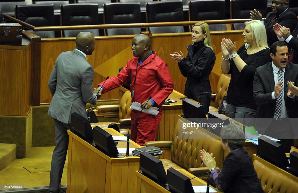 Economic Freedom Fighters leader Julius Malema shakes hands with DAs Mmusi Maimane during Parliaments post municipal elections debate on August 23...