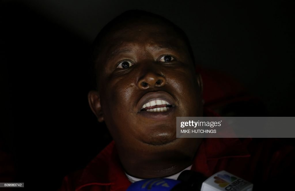 Economic Freedom Fighters (EFF) leader Julius Malema speaks to journalists after being ordered to leave the parliamentary chamber during President Jacob Zuma's State of the Nation address in Cape Town on February 11, 2016. South Africa's radical leftist Economic Freedom Fighters (EFF) party walked out of President Jacob Zuma's state of the nation address after repeatedly interrupting his speech in chaotic parliamentary scenes. / AFP / AP / MIKE HUTCHINGS