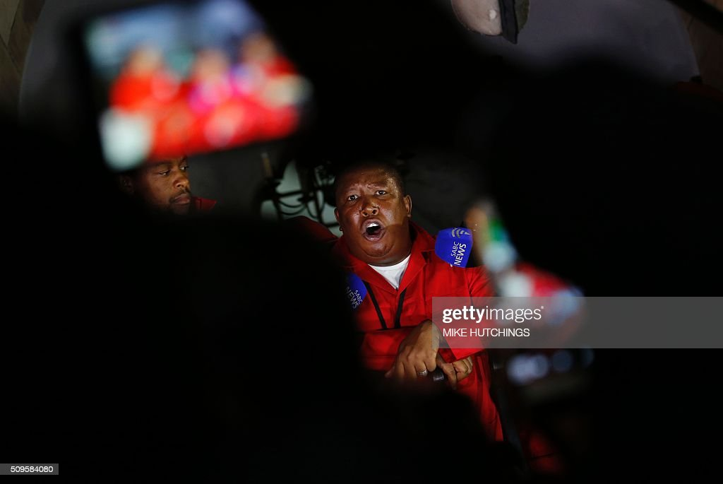 Economic Freedom Fighters (EFF) leader Julius Malema speaks to journalists after being ordered to leave the parliamentary chamber during President Jacob Zuma's State of the Nation address in Cape Town, February 11, 2016. South Africa's radical leftist Economic Freedom Fighters (EFF) party walked out of President Jacob Zuma's state of the nation address after repeatedly interrupting his speech in chaotic parliamentary scenes. / AFP / POOL / MIKE HUTCHINGS