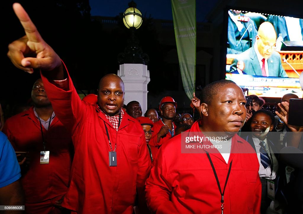 Economic Freedom Fighters (EFF) leaders Floyd Shivambu (L) and Julius Malema (R) leaves parliament after being ordered to do so during President Jacob Zuma's annual State of the Nation Address in Cape Town, February 11, 2016. South Africa's radical leftist Economic Freedom Fighters (EFF) party walked out of President Jacob Zuma's state of the nation address after repeatedly interrupting his speech in chaotic parliamentary scenes. / AFP / MIKE HUTCHINGS