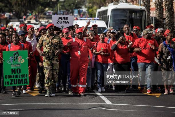 Economic Freedom Fighters opposition party's members march to support a Motion of no Confidence against South African President Zuma to be debated in...