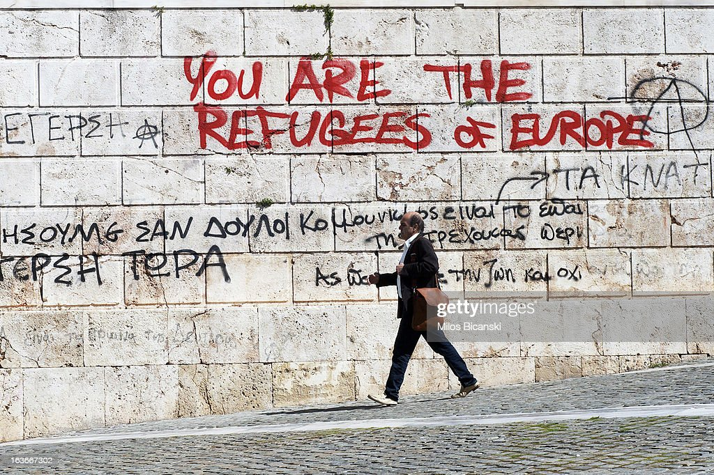 Economic related graffiti adorns a wall on March 13, 2013, at the Panapestimiou Street, Athens. The numbers of homeless in Athens is rising rapidly as businesses face bankruptcy and workers with work find themselves unable to pay their bills. Homelessness has soared by an estimated 25% since 2009 as Greece struggles to deal with the euro zone economic crisis. Greece is in its fifth year of recession and the official unemployment figures are rising towards 20%. Tensions between Greece and Germany are growing as Greeks struggle to deal with the austerity measures set in order for Greece to receive EU bailout money.