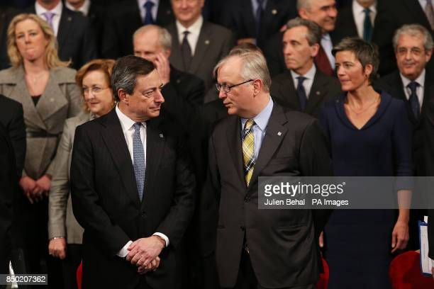EU Economics Commissioner Olli Rehn and Mario Draghi European Central Bank President during the family photo in Dublin Castle during the informal...