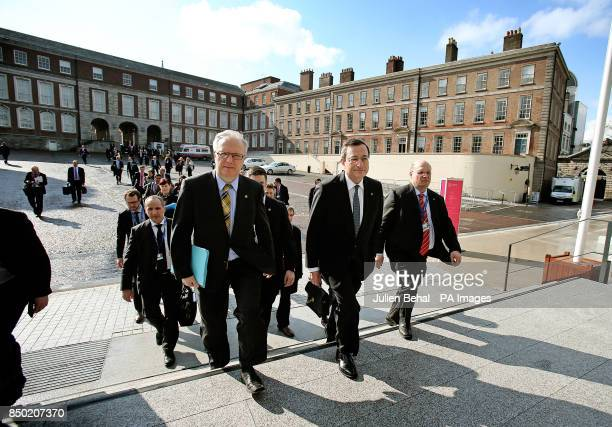 EU Economics Commissioner Olli Rehn and Mario Draghi European Central Bank President lead delegates up steps on their way to the Tour de Table in...