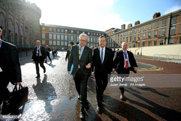 EU Economics Commissioner Olli Rehn and Mario Draghi European Central Bank President on their way to the Tour de Table in Dublin Castle's courtyard...
