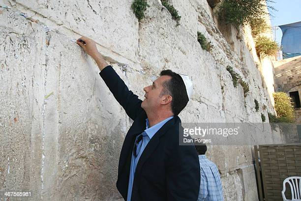 Economist and Vice Chairman of Blackrock Philipp Hildebrand places a wishing note on the Wailing Wall during a sightseeing tour of the Old City of...