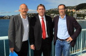 Economist Gareth Morgan CEO of the ALeague Lyall Gorman and Investment banker Rob Morrison pose after a Wellington Phoenix press conference at the...