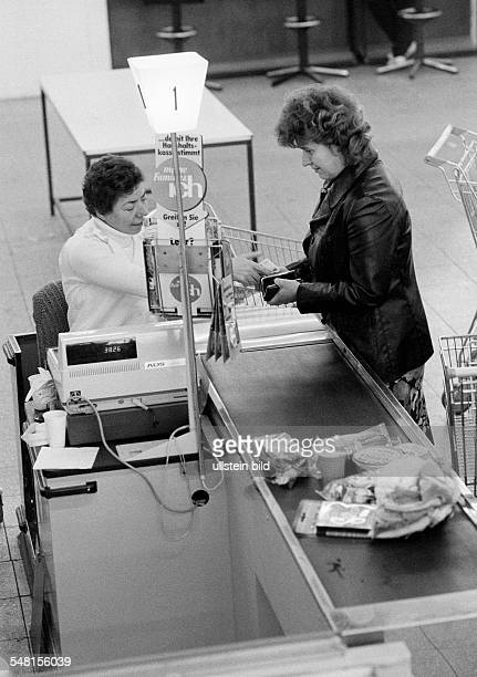 economy cashier and customer at a checkout counter in a supermarket women aged 40 to 50 years aged 50 to 60 years DOberhausen DOberhausenSterkrade...