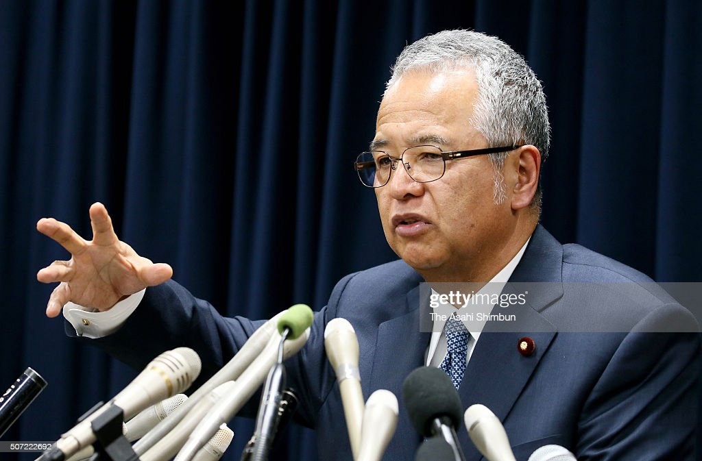 Economy minister <a gi-track='captionPersonalityLinkClicked' href=/galleries/search?phrase=Akira+Amari&family=editorial&specificpeople=3868034 ng-click='$event.stopPropagation()'>Akira Amari</a> attends a news conference announcing his resignation on January 28, 2016 in Tokyo, Japan. Amari announced his resignation to take responsibility for a bribery scandal but insisted the 1 million Japanese yen (8,400 U.S. dollars) he received from a construction company was clean.