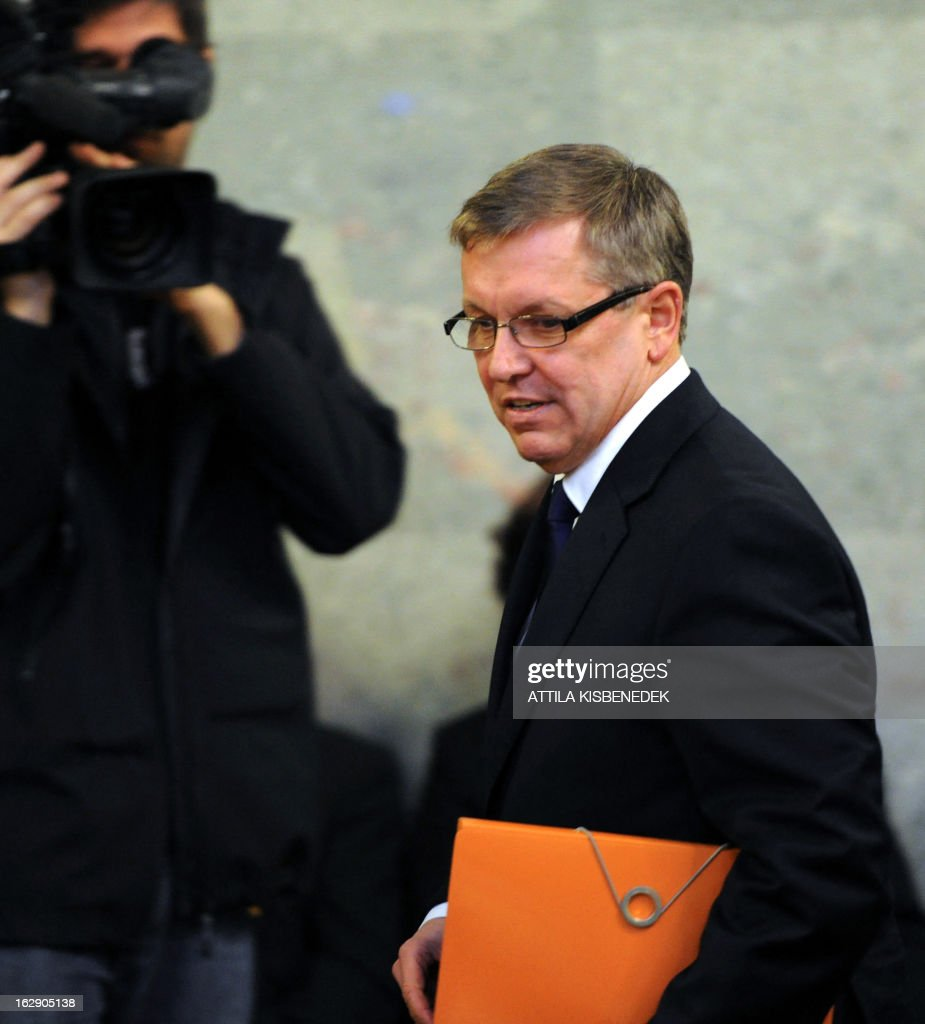 Economy minister of Hungary's Orban's government Gyorgy Matolcsy arrives for a hearing at the Economy committee of the Hungarian Parliament in Budapest on March 1, 2013. Hungary's Prime Minister Viktor Orban named a close ally, the controversial Economy Minister Gyorgy Matolcsy, as the new head of the country's central bank (MNB), a move that had investors worried of resurging inflation and renewed instability. AFP PHOTO / ATTILA KISBENEDEK