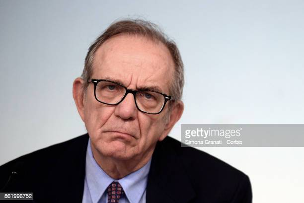 Economy Minister Pier Carlo Padoan speaking at a press conference after cabinet on the 2018 budget bill just approved by cabinet on October 16 2017...