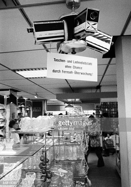 economy retailing shoplifting prevention deterrence observation camera in a store indicating label