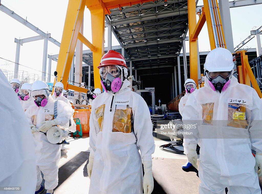 Economy, Trade and Industry Minister Yuko Obuchi (C) inspects the Fukushima Daiichi Nuclear Power Plant on September 7, 2014 in Okuma, Fukushima, Japan.