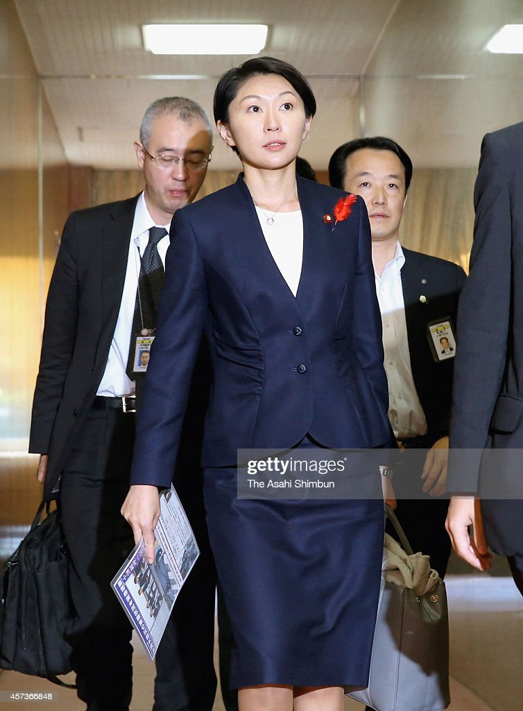 Economy, Trade and Industry Minister Yuko Obuchi leaves after an economy, trade and industry committee session of the lower house at the diet building on October 17, 2014 in Tokyo, Japan. Allegations emerged that her political funds were used to purchase theater tickets and meals for her supporters, a possible elections law violation.