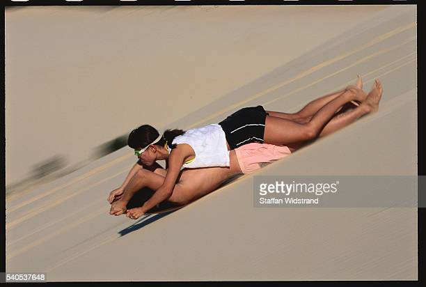 Ecotourists Sand Tobogganing