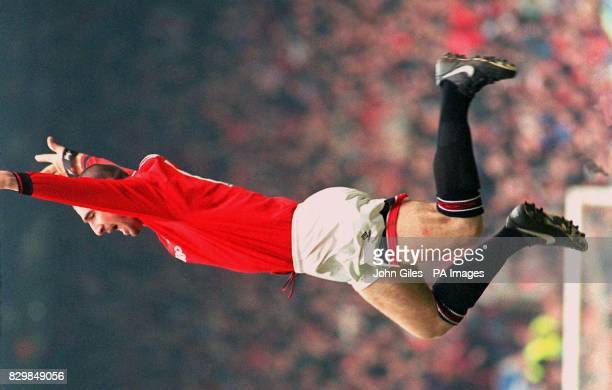 Ecstasy again for Eric Cantona as he jumps high after scoring the only goal for Manchester United to give them victory over Coventry in the...