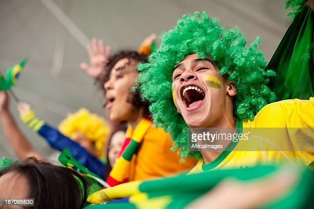 Ecstatic Brazilian fan watching a Football game