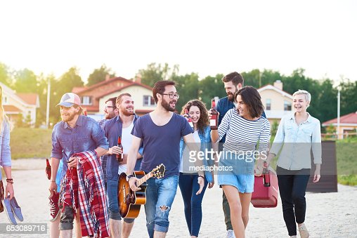 Ecstatic friends on beach : Stock Photo