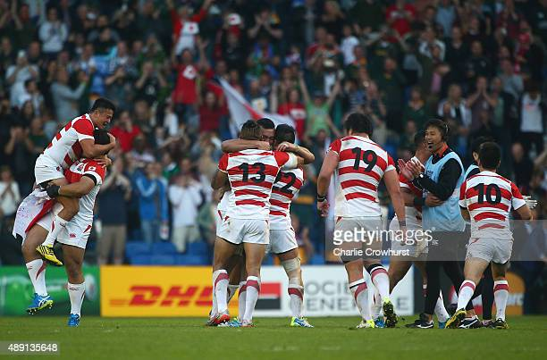 Ecstatic Japan players celebrate following their surprise victory during the 2015 Rugby World Cup Pool B match between South Africa and Japan at the...