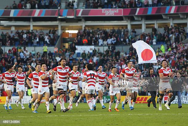 Ecstatic Japan players celebrate their surprise victory in the 2015 Rugby World Cup Pool B match between South Africa and Japan at the Brighton...