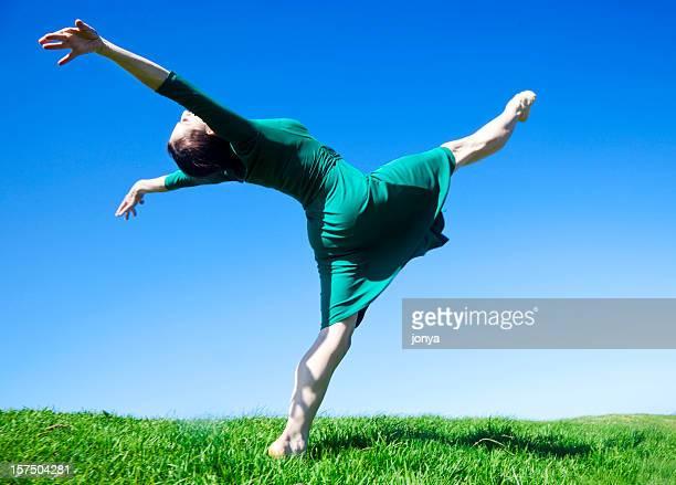 ecstatic modern dancer lifting leg to the sky