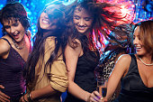 Young women having fun dancing at nightclub