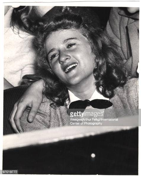 Ecstatic young fan Virginia Schneider smiles while attending a Frank Sinatra concert as an audience member at the Paramount Theater New York November...