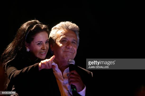 Ecuadoran presidential candidate Lenin Moreno and wife Rocio Gonzales speak to supporters on February 19 2017 in Quito Ecuador's presidential...