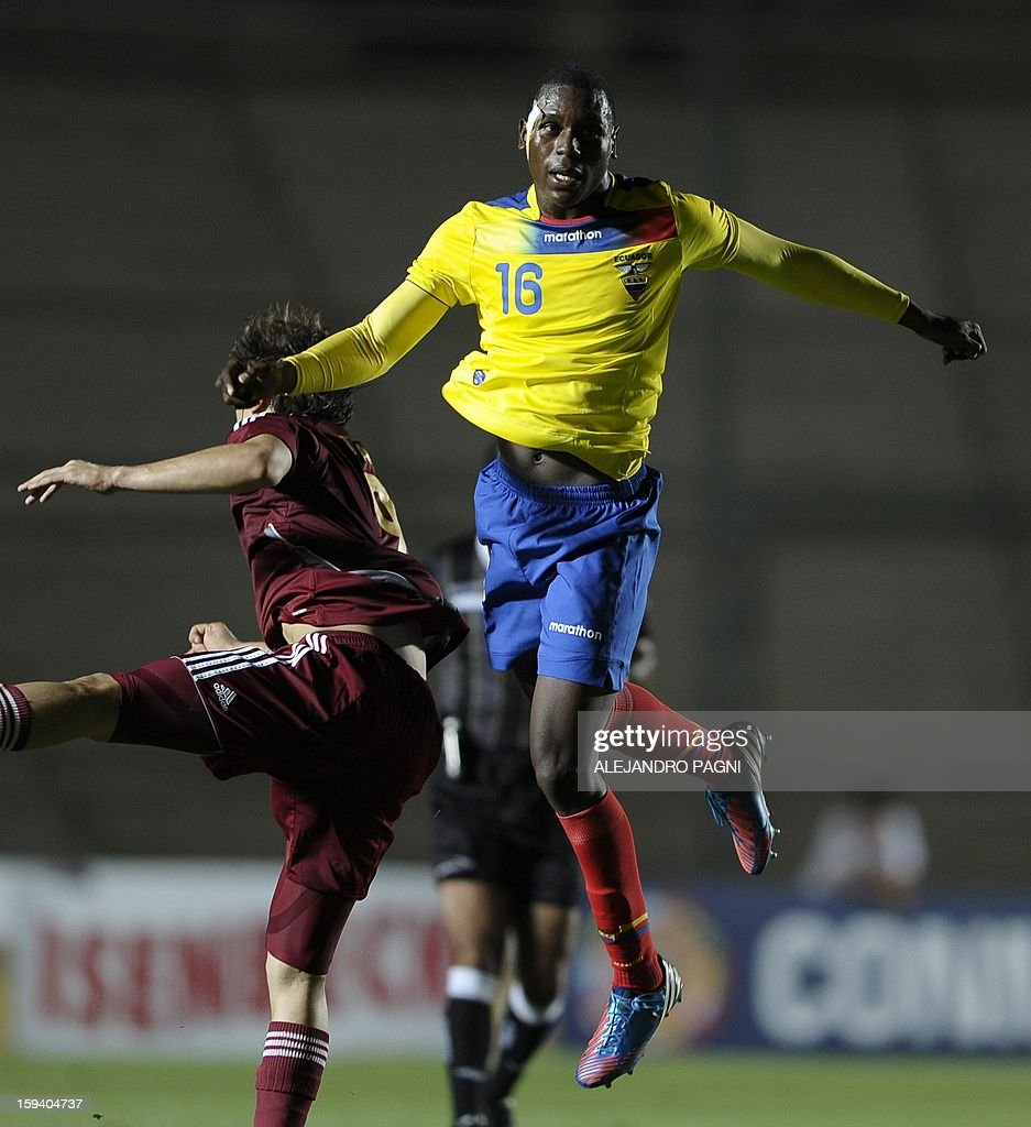 Ecuadorean defender Anderson Ordonez (R) jumps for controls the ball during their South American U-20 Championship Group B football match against Venezuela, at Bicentenario stadium in San Juan, Argentina, on January 12, 2013. Four South American teams will qualify for the FIFA U-20 World Cup Turkey 2013.