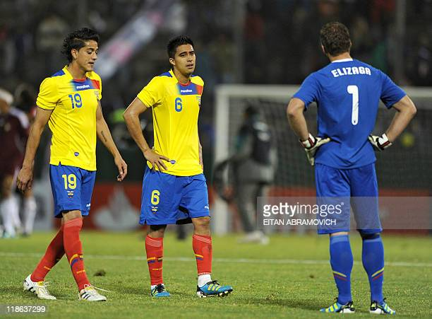 Ecuadorean defender Norberto Araujo midfielder Cristhian Noboa and goalkeeper Marcelo Elizaga leave the pitch at the end of their 2011 Copa America...