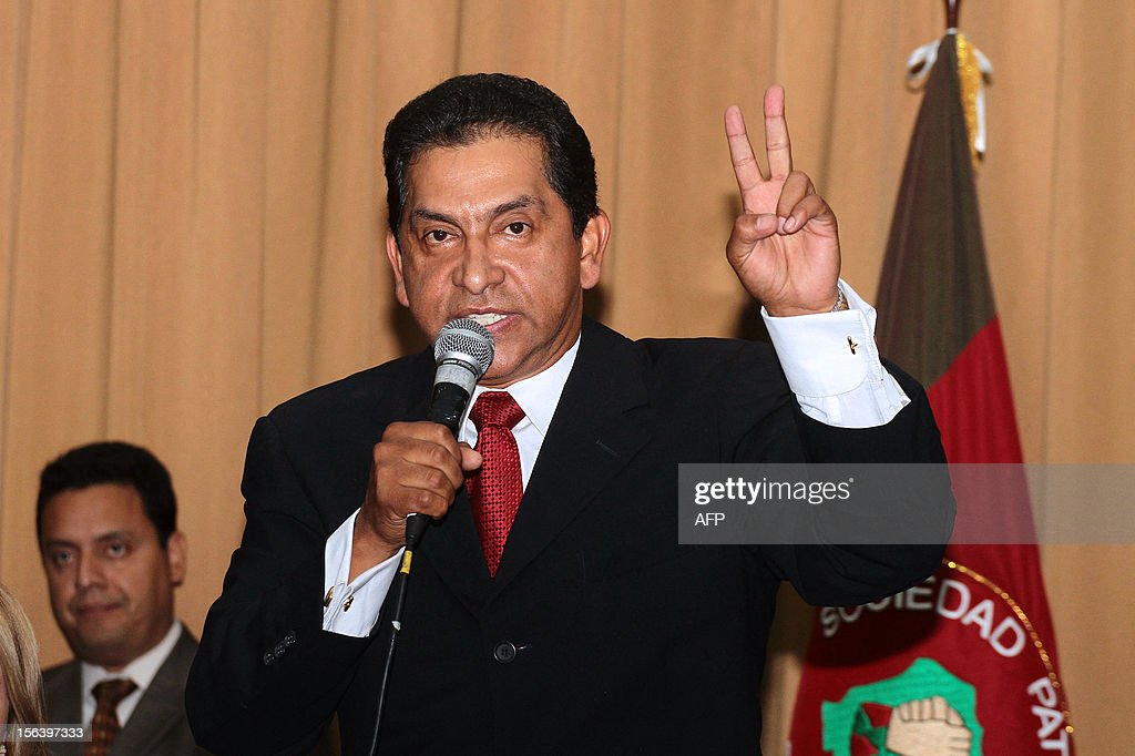 Ecuadorean former president (2003-2005) and presidential candidate for the Patriotic Society Movement, Lucio Gutierrez, flashes the V sign as he dlivers a speech after registering his candidacy for the 2013 general elections on November 14, 2012 in Quito. Leftist President Rafael Correa, who has led the Andean nation of 14 million people since 2007, is currently far ahead in opinion polls, winning 56 percent support among likely voters. Far behind are Gutierrez at 23 percent and right-wing banker Guillermo Lasso Lasso at 22 percent, according to a recent survey carried out by the private Cedatos polling institute.