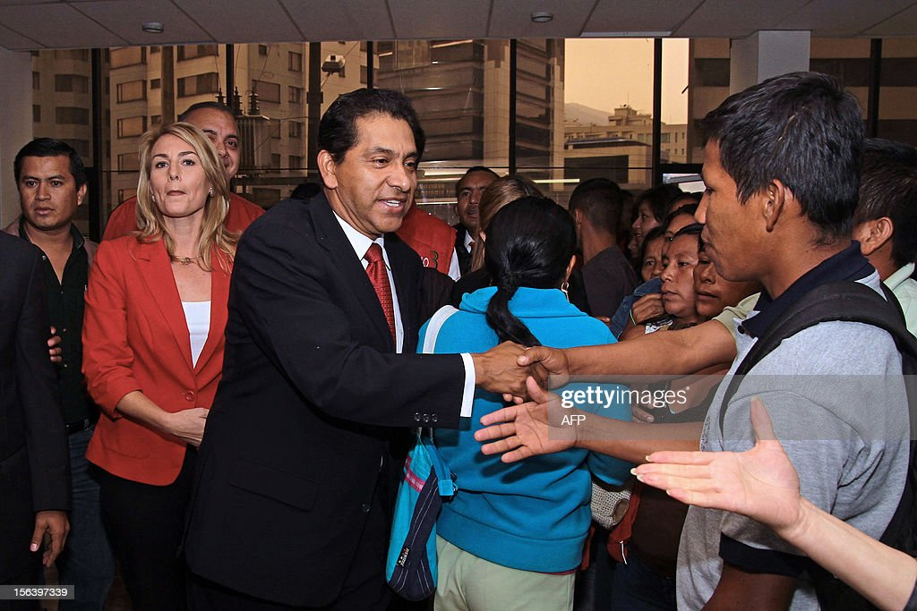 Ecuadorean former president (2003-2005) and presidential candidate for the Patriotic Society Movement, Lucio Gutierrez (C), shakes hands with supporters next to his candidate for Vice-President Pearl Ann Boyes (2-L), after registering their candidacy for the 2013 general elections on November 14, 2012 in Quito. Leftist President Rafael Correa, who has led the Andean nation of 14 million people since 2007, is currently far ahead in opinion polls, winning 56 percent support among likely voters. Far behind are Gutierrez at 23 percent and right-wing banker Guillermo Lasso Lasso at 22 percent, according to a recent survey carried out by the private Cedatos polling institute.