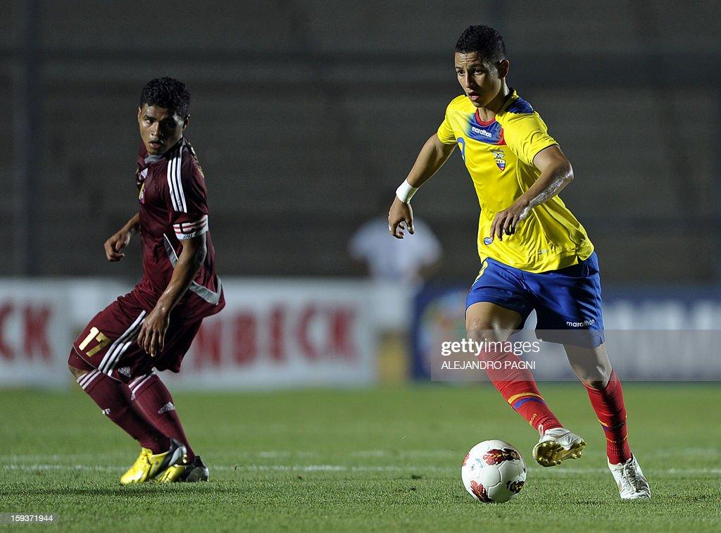 Ecuadorean forward Miguel Parrales (R) controls the ball past Venezuelan forward Josef Martinez during their South American U-20 Championship Group B football match at Bicentenario stadium in San Juan on January 12, 2013. Four South American teams will qualify for the FIFA U-20 World Cup Turkey 2013.