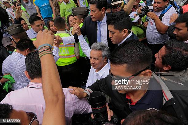 Ecuadorean Lenin Moreno arrives to deliver a speech after he was annouced as presidential candidate for the Alianza Pais party in Quito on October 1...