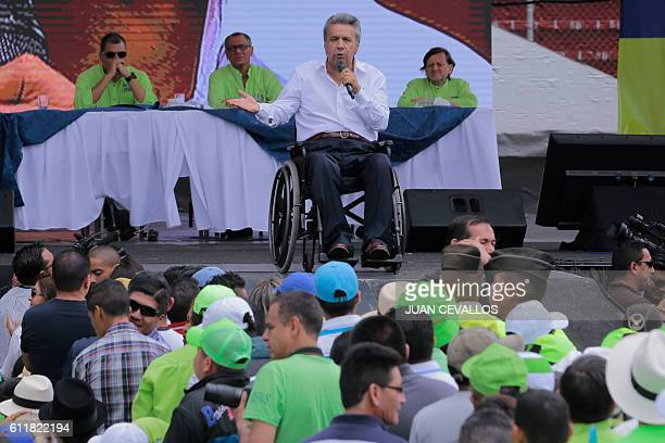 Ecuadorean Lenin Moreno delivers a speech after he was annouced as presidential candidate for the Alianza Pais party next to Ecuadorean Presidnet...