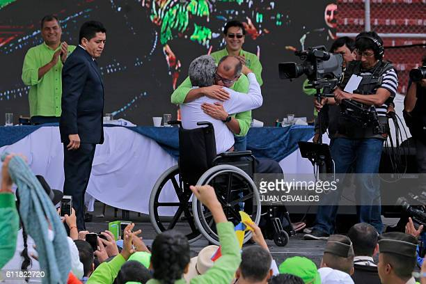 Ecuadorean Lenin Moreno embraces Ecuadorean VicePresident Jorge Glas after presenting him as his running mate after he was annouced as presidential...