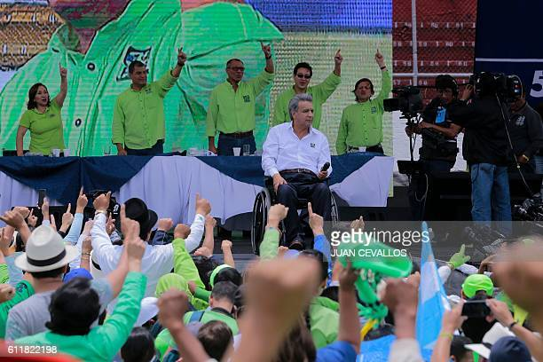 Ecuadorean Lenin Moreno prepares to deliver a speech after he was annouced as presidential candidate for the Alianza Pais party next to Ecuadorean...