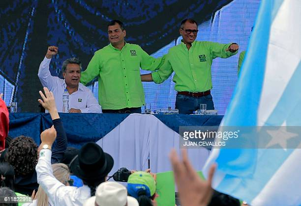 Ecuadorean Lenin Moreno raises his fist next to Ecuadorean President Rafael Correa and Ecuadorean VicePresident Jorge Glas after he was annouced as...