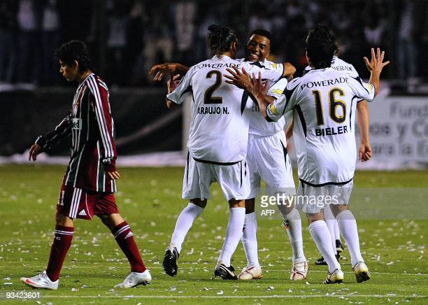 Ecuadorean Liga de Quito's players celebrate after scoring against Brazilian Fluminense during their 2009 Copa Sudamericana first leg final football...