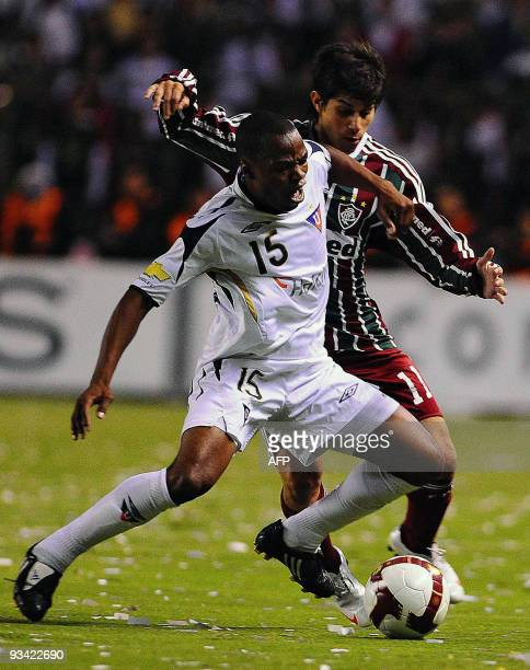 Ecuadorean Liga de Quito's Willian Araujo vies for the ball with Brazilian Fluminense's Conca during their 2009 Copa Sudamericana first leg final...