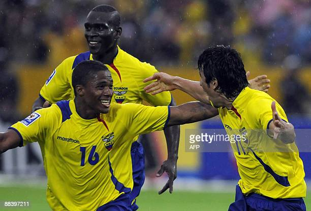 Ecuadorean national soccer players Pablo Palacios and Antonio Valencia celebrate after scoring against Argentina during their FIFA World Cup South...