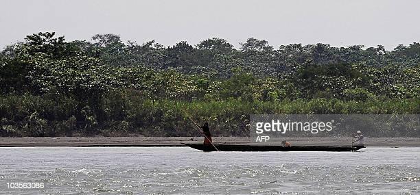 STORY Ecuadorean natives cross the Napo river at the Yasuni National Park at the Ecuadorean Amazon forest on August 21 2010 AFP PHOTO / RODRIGO...